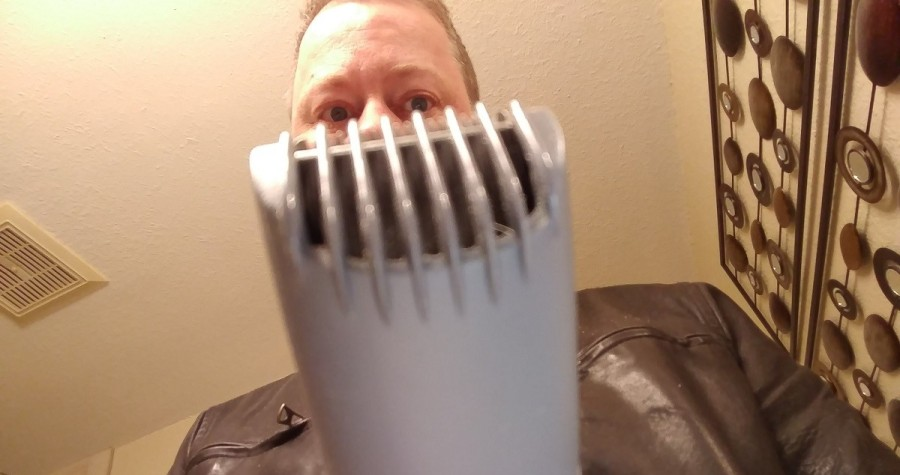 author looking at beard trimmer