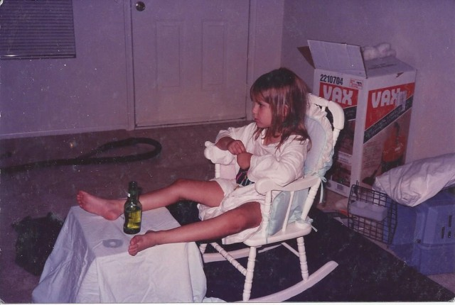 4-year-old-goddaughter Alexa Seagraves watching tv drinking water out of a beer bottle