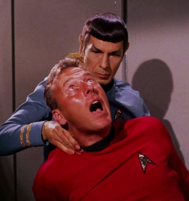 Spock administering a Vulcan Nerve Pinch to a redshirt