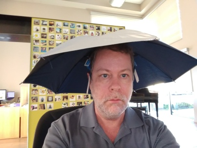 the author wearing an umbrella hat