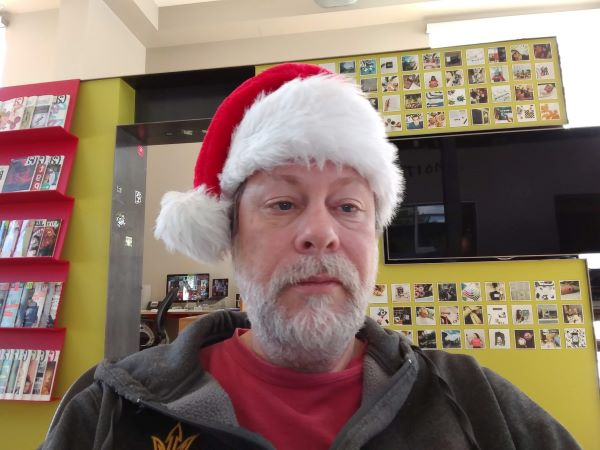 Author with white beard and Santa hat
