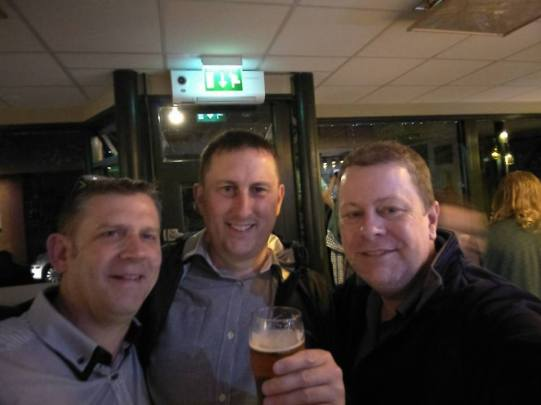 Sean Layton in a pub with his cousin Martin center and a friend.