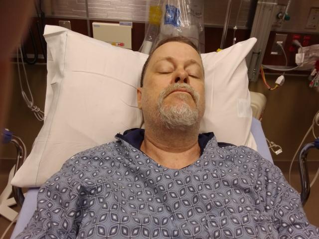 Author on a hospital gurney