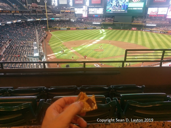Eating dessert and relaxing in a suite before the DBacks' game.