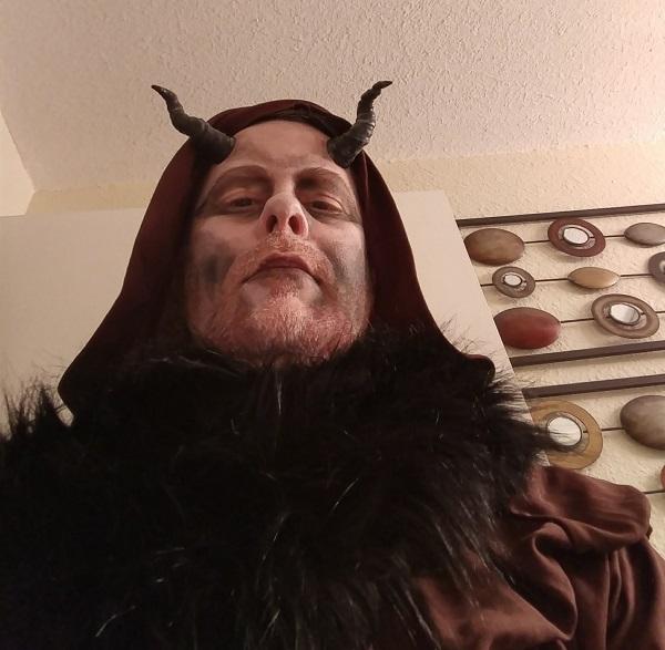 dressed like a demonic cultist
