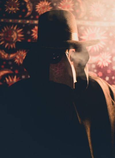 secretive group member in a plague mask from a night terror
