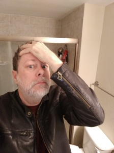 The author despairing over his broken toilet.