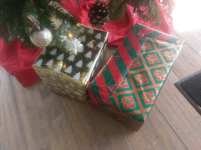 The author's bad wrapping job next to a shiny, well-wrapped present