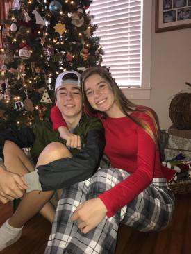 My nephew Santi and niece Mary in front of the Xmas tree